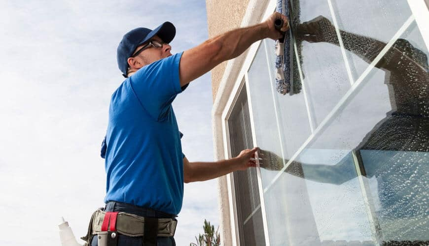Certified Cleaner Cleaning WIndow glass